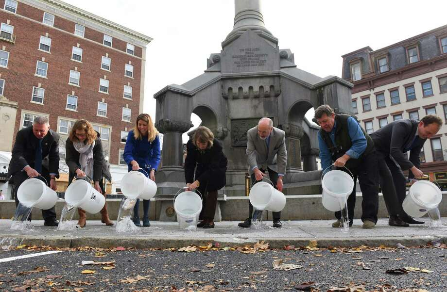 Mayor Patrick Madden joined by local business and community representatives to commemorate the completion of Troy's Green Infrastructure Redevelopment Project on Thursday Nov. 17, 2016 in Troy, N.Y.  (Michael P. Farrell/Times Union) Photo: Michael P. Farrell / 20038828A