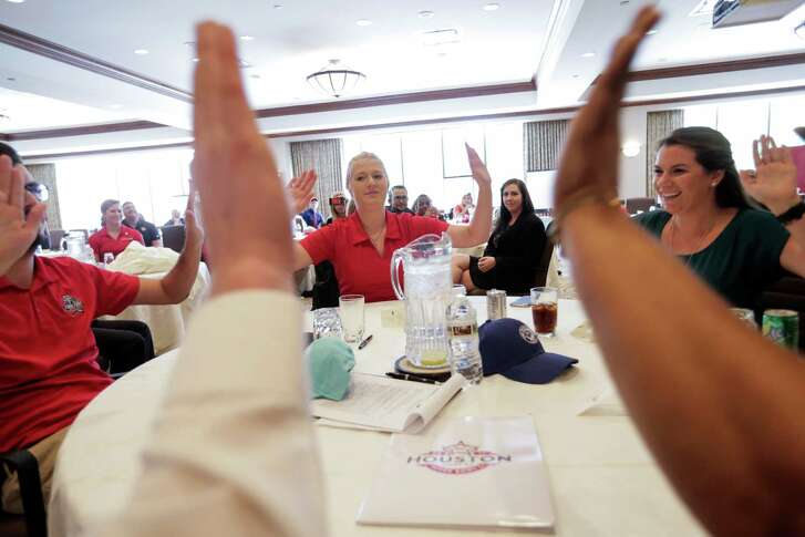 University of Houston students participate in a team-building challenge as part of a hospitality training session Friday in preparation for the Super Bowl coming to NRG Stadium in February.