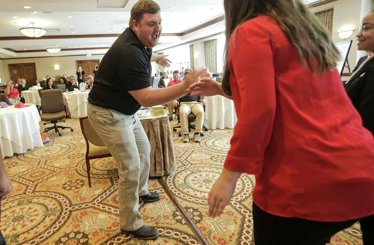 Evan Dunbar, a first year sports and fitness admin. graduate student at University of Houston participates in a team-building exercise during a hospitality training session for major sporting event operations training Super Bowl-related events on Friday, Nov. 11, 2016, in Houston. ( Elizabeth Conley / Houston Chronicle )
