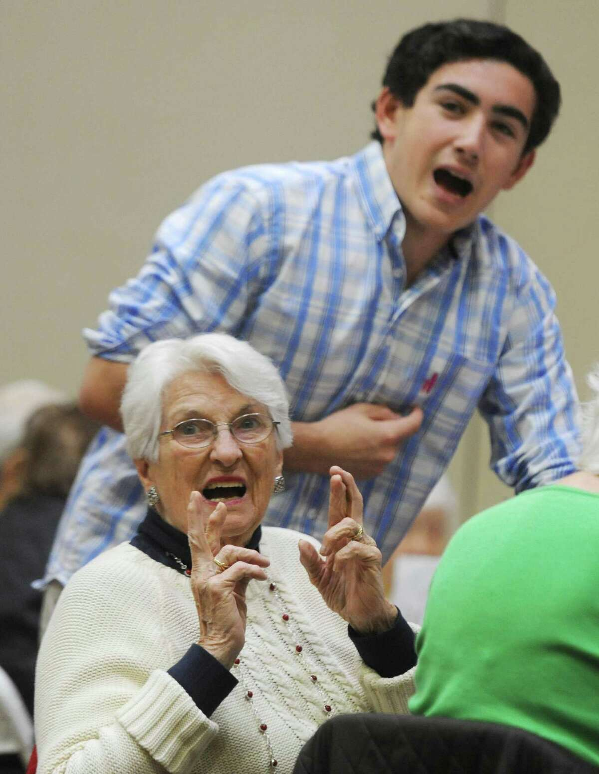 Bernice Carroll, of Riverside, crosses her fingers that all of her numbers are correct after calling Bingo during Senior Bingo Day at Temple Sholom in Greenwich, Conn. Sunday, Nov. 13, 2016. More than 100 seniors gathered to play Bingo, with each round being a different variation of the game such as straight line and postage stamp. The group was treated to a short performance by the Temple Sholom Youth and Junior Choir.