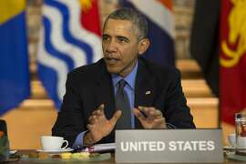 FILE - In this Dec. 1, 2015 file photo, President Barack Obama speaks during a meeting with heads of state from small island nations most at risk from the harmful effects of climate change, in Paris. If the nation doesn�t do more, the United States probably won�t quite meet the dramatic heat-trapping gas reduction goal it promised in last year�s Paris agreement to battle climate change, according to a new study.  (AP Photo/Evan Vucci, File)