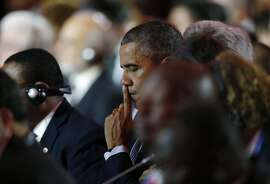 TOPSHOTS US President Barack Obama (C) reacts during the opening ceremony of the World Climate Change Conference 2015 (COP21) at Le Bourget, near Paris, on November 30, 2015. More than 150 world leaders are meeting under heightened security, for the 21st Session of the Conference of the Parties to the United Nations Framework Convention on Climate Change (COP21/CMP11), also known as Paris 2015 from November 30 to December 11.  AFP PHOTO / POOL / STEPHANE MAHESTEPHANE MAHE/AFP/Getty Images