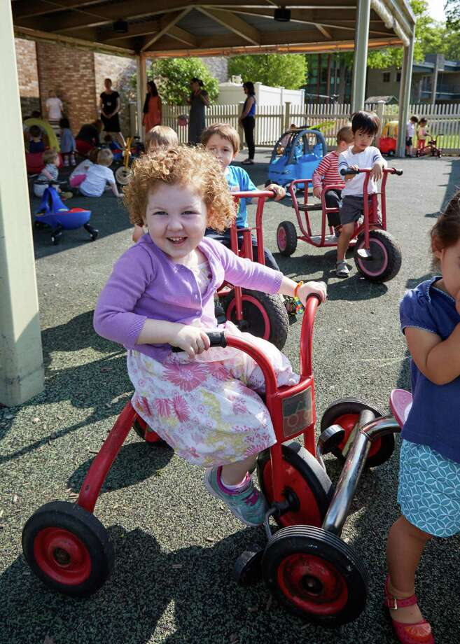 Three-year-old Cecilia Gentile plays on a tricycle in the Whitby School playground. Parents and staff were told that play is as important to a child's growth as academics. Photo: Contributed