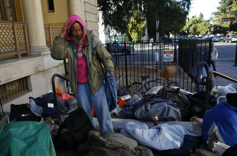 "Mike Lee surveys his remaining belongings outside of the US Postal Office on Allston Way in Berkeley, Calif., after he and his group were removed from their spot across the street earlier in the morning by police on Nov. 17, 2016. The group of homeless were moved by the Berkeley Police Department from the lawn where they had been camping outside of the Martin Luther King Jr. Civic Center early on Thursday morning. The encampment, which calls itself ""First they Came for the Homeless"" has been protesting the Berkeley food and housing project for weeks. Photo: Leah Millis, The Chronicle"