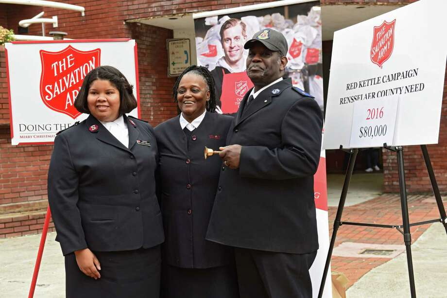 From left, Lt. Alberta Rakestraw, Envoy Vangerl Pegues and her husband Envoy James Pegues stand in front of signs during the Capital Region Salvation Army Annual Red Kettle Kick-off on in front of the Troy Atrium on Thursday, Nov. 17, 2016 in Troy, N.Y. (Lori Van Buren / Times Union) Photo: Lori Van Buren / 20038854A