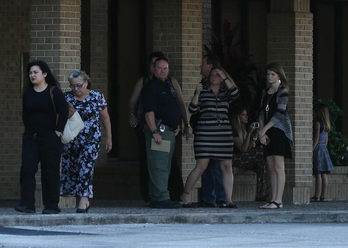 Loved ones attend a Nov. 17 Baytown memorial service for Cynthia Morris, 37; Breanna Pavilicek, 13; and Kirsten Fritch, 16.