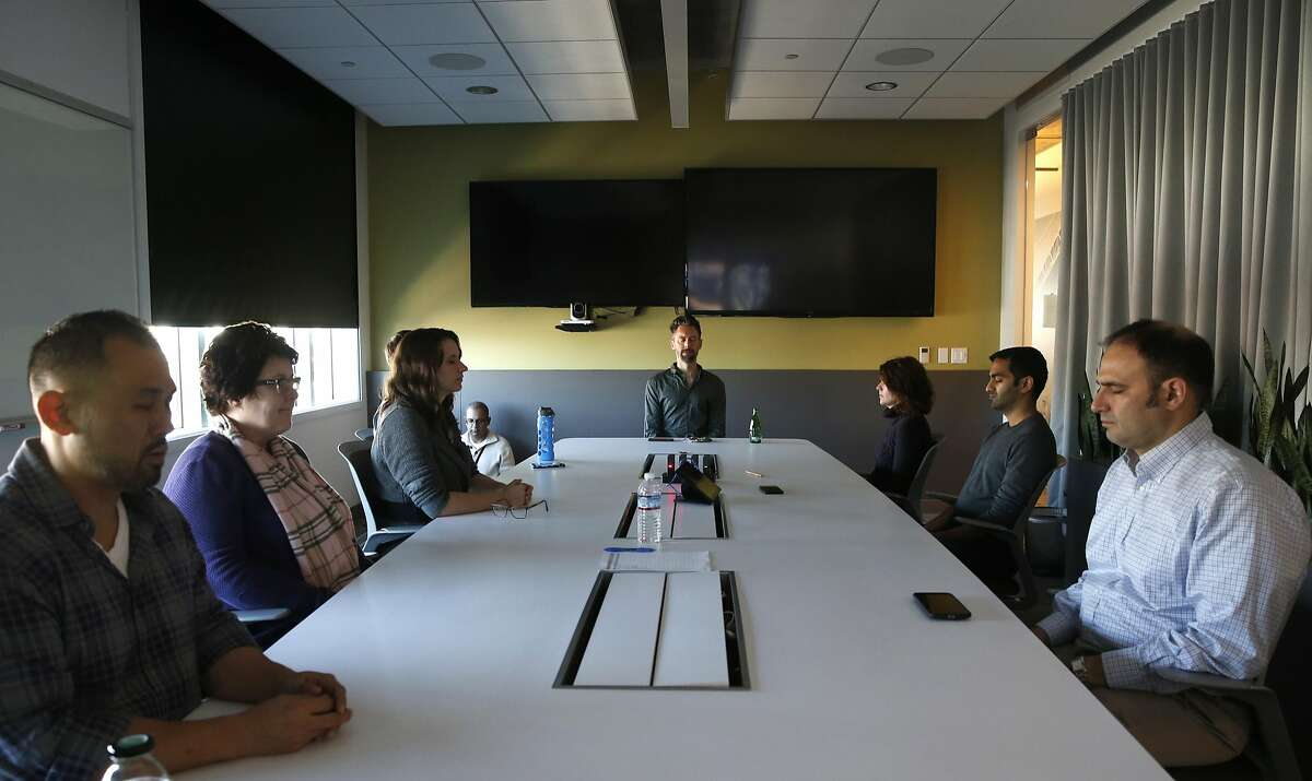 Chad Stose (center) leads a meditation session for employees of Ancestry.com in the company's offices in San Francisco, Calif. on Thursday, Nov. 17, 2016.