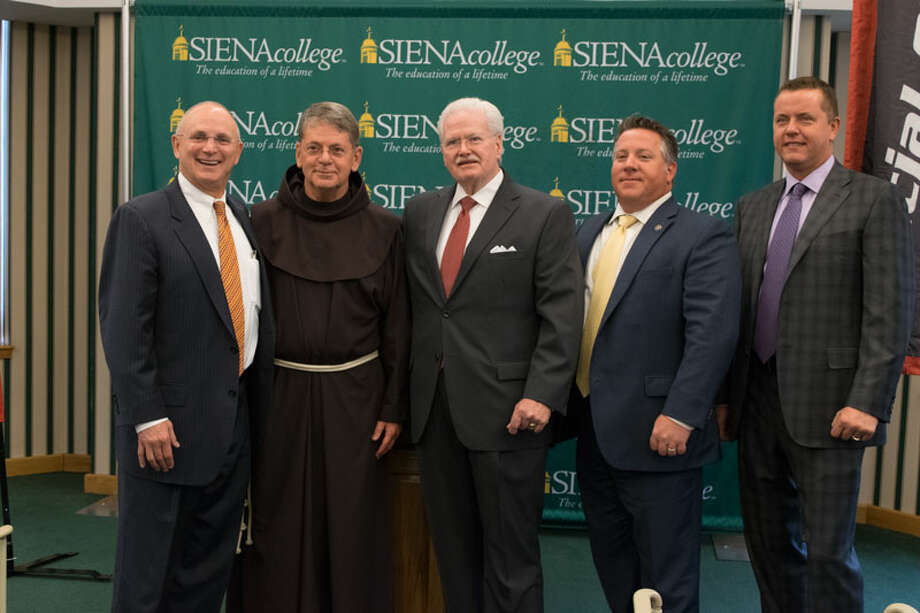 Hudson Valley Community College President Andrew J. Matonak, Siena College President Brother F. Edward Coughlin, Special Olympics New York CEO Neal Johnson, Albany County Executive Dan McCoy and Albany County Sheriff Craig Apple attend a press conference at Siena College in Loudonville, NY on Thursday, November 17, 2016. (Photo provided by Siena College)