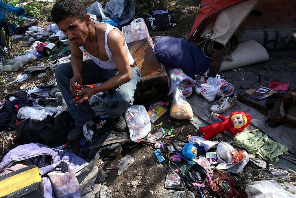 "LOMITA, CA - FEBRUARY 23, 2016 - Richard Lopez, 32, sits in his homeless encampment trying to decide what belongings to gather before sanitation crews arrive to clear him out of an area called, ""The Pit,"" alongside the 110 freeway in Lomita on February 23, 2016.A joint operation of CalTrans, LASO, LAPD, Los Angeles Homeless Services Authority outreach workers and Department of Mental Health are clearing a homeless encampment in the area. (Photo by Genaro Molina/Los Angeles Times via Getty Images) Photo: Genaro Molina, LA Times Via Getty Images"