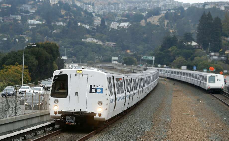 Trains arrive and depart at the Rockridge BART station in Oakland, Calif. on Wednesday, Oct. 12, 2016. BART officials are hoping voters will approve a $3.5 million bond measure to improve the aging infrastructure of the transit system. Photo: Paul Chinn, The Chronicle