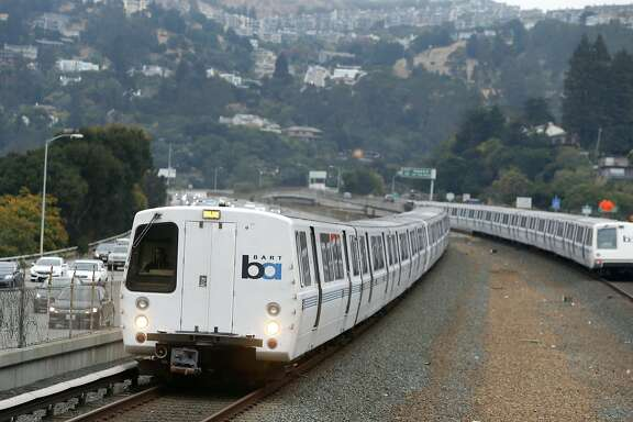 Trains arrive and depart at the Rockridge BART station in Oakland, Calif. on Wednesday, Oct. 12, 2016. BART officials are hoping voters will approve a $3.5 million bond measure to improve the aging infrastructure of the transit system.
