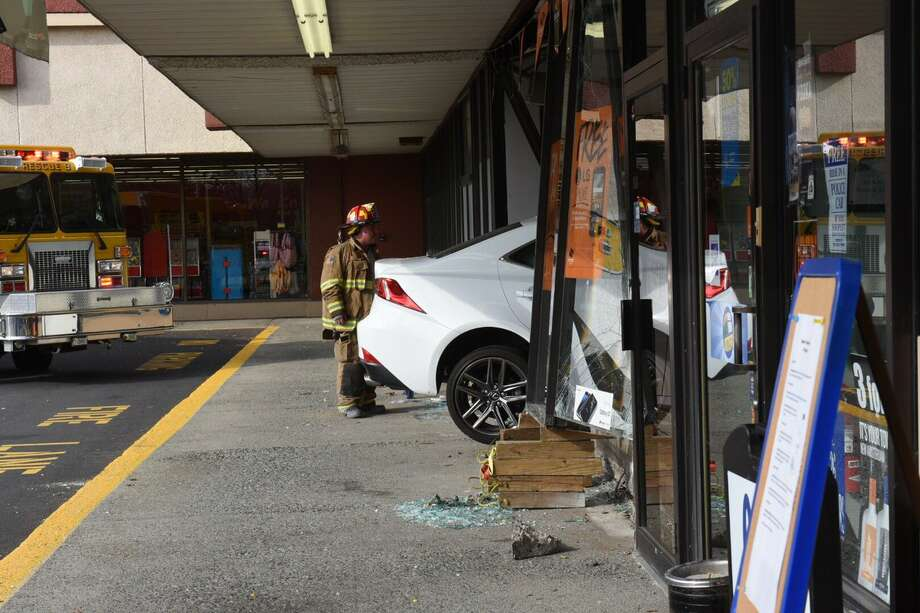 A car crashed through the front window of the Boost Mobile store on Route 32 in Menands on Thursday. (Lori Van Buren / Times Union)