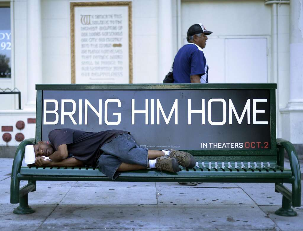 LOS ANGELES, CA - SEPTEMBER 23: A homeless man sleeps on a bus bench on September 23, 2015, in Los Angeles, California. Mayor Eric Garcetti and City Council members declared public emergency, the first city in the nation to take drastic step in response to increase in homelessness and that they're ready to spend $100 million per year to fight it. (Photo by Kevork Djansezian/Getty Images) Photo: Kevork Djansezian, Getty Images