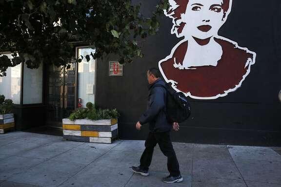 A man walks past closed La Urbana on Divisadero Nov. 17, 2016 in San Francisco, Calif.