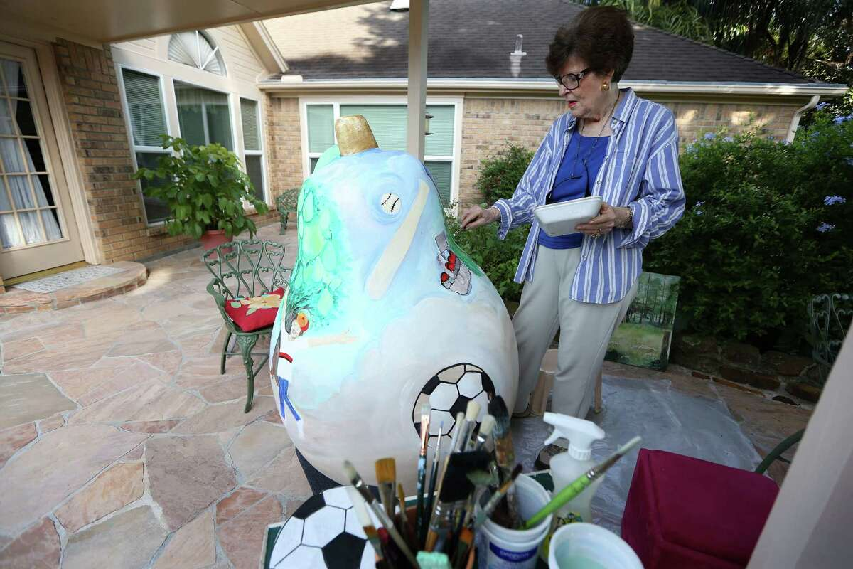 Josephine Eager decorates a pear sculpture on her patio Thursday, Aug. 4, 2016, in Pearland. Eager is one of several artists chosen to decorate pear sculptures that will be placed in various places around Pearland as a civic branding exercises. The city was Pearland was praised in a new Kinder Insitute report for using citizen surveys to prioritize projects. ( Steve Gonzales / Houston Chronicle )