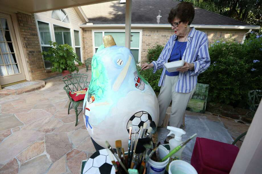 Josephine Eager decorates a pear sculpture on her patio Thursday, Aug. 4, 2016, in Pearland. Eager is one of several artists chosen to decorate pear sculptures that will be placed in various places around Pearland as a civic branding exercises. The city was Pearland was praised in a new Kinder Insitute report for using citizen surveys to prioritize projects. ( Steve Gonzales  / Houston Chronicle  ) Photo: Steve Gonzales / © 2016 Houston Chronicle