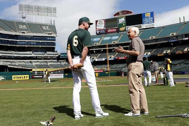 Oakland Athletics' owner Lew Wolff chats with manager Bob Melvin before the A's play the Houston Astros in MLB game at O.co Coliseum in Oakland, Calif. on Tuesday, July 22, 2014.