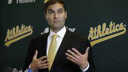 New Oakland Athletics President David Kaval gestures during a media conference on Thursday, Nov. 17, 2016, in Oakland, Calif. (AP Photo/Ben Margot)