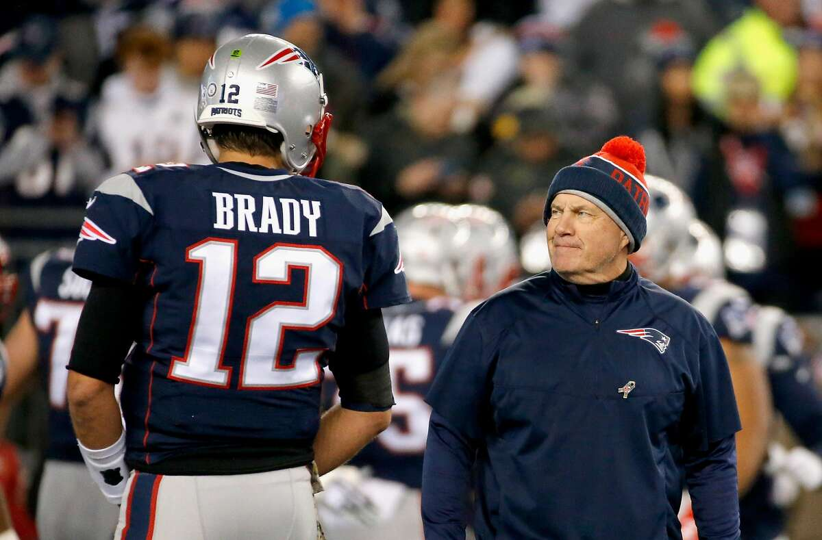 FOXBORO, MA - NOVEMBER 13: Head coach Bill Belichick talks with Tom Brady #12 of the New England Patriots before a game against the Seattle Seahawks at Gillette Stadium on November 13, 2016 in Foxboro, Massachusetts. (Photo by Jim Rogash/Getty Images)