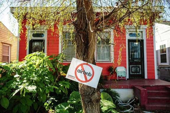 -- PHOTO MOVED IN ADVANCE AND NOT FOR USE - ONLINE OR IN PRINT - BEFORE MARCH 06, 2016. -- A sign opposing Airbnb in the front yard of a home on St. Anthony Street in the 7th Ward neighborhood, near the French Quarter in New Orleans, Feb. 7, 2016. Opponents of the rise of the short-term rentals in the city complain that the strangers squeeze out long-term residents, but supporters say renting out rooms allows them to make extra income. (William Widmer/The New York Times)