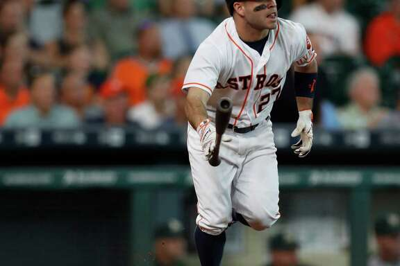 Houston Astros second baseman Jose Altuve (27) tosses his bat as he watches his ball fly out for an RBI triple, which tied the game during the eighth inning of an MLB game at Minute Maid Park, Wednesday, Aug. 31, 2016 in Houston. ( Karen Warren / Houston Chronicle )