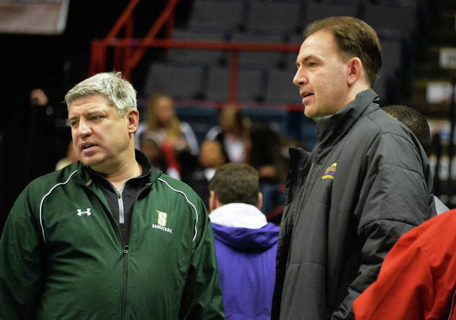 Siena coach Jimmy Patsos, left, and UAlbany coach Will Brown before the start of the Class A Federation boys' basketball final between Scotian and Holy Trinity at the Times Union Center Saturday March 22, 2014, in Albany, NY.  (John Carl D'Annibale / Times Union) Photo: John Carl D'Annibale / 00026204A