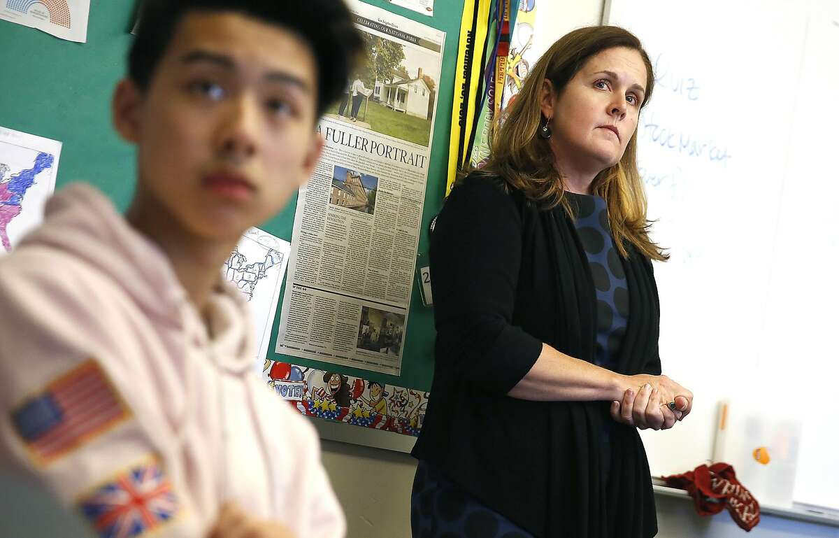 History teacher Valerie Ziegler (right) teaches eleventh grade students including Winky Fong (left) sourcing at Lincoln High School on Thursday, November 17, 2016, in San Francisco, Calif.