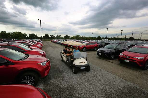 Customers are driven through rows of new Toyota RAV4's at the Sterling McCall Toyota dealership on the Southwest Freeway, Thursday, Oct. 20, 2016, in Houston. ( Mark Mulligan / Houston Chronicle )