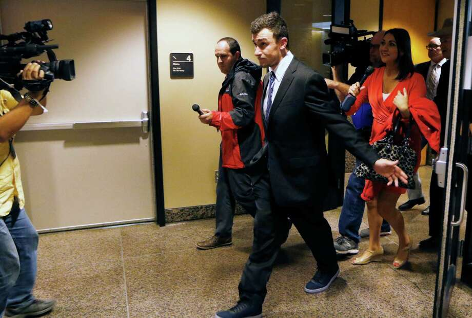 Heisman Trophy-winning quarterback Johnny Manziel leaves the Frank Crowley Courts Building, Thursday, Nov. 17, 2016, in Dallas. Manziel has reached a deal with prosecutors for the conditional dismissal of a domestic assault case involving his former girlfriend. Defense attorney Jim Darnell said there was still work to be done to finalize the deal, but said after the hearing that he was encouraged. A judge set another hearing for Dec. 1, when the case could be settled. (David Woo/The Dallas Morning News via AP) Photo: MBR / The Dallas Morning News