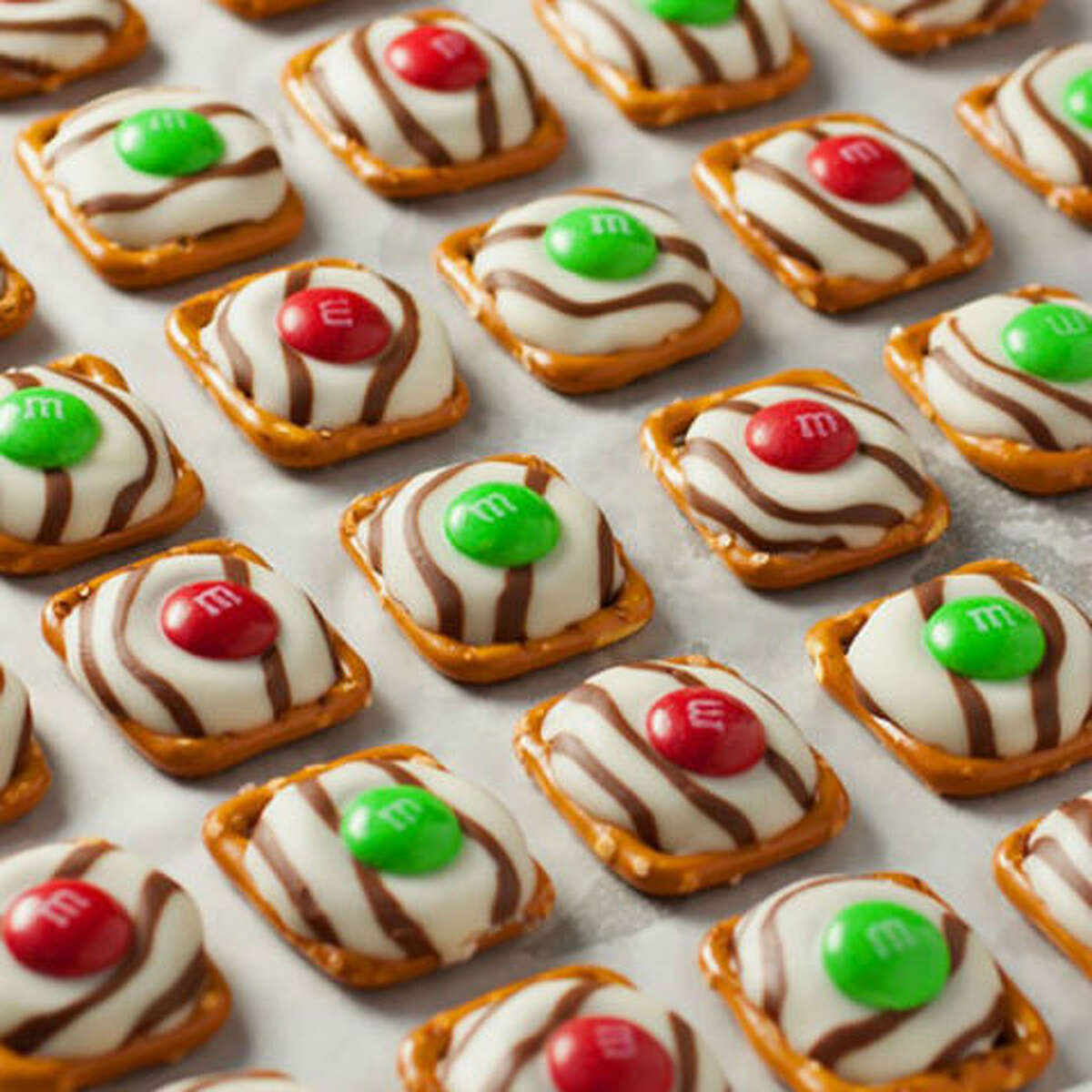 CHRISTMAS PRETZEL M&M HUGS These are the perfect balance of salty and sweet, and made with just three ingredients you can pick up at the drugstore. Get the recipe at Hoosier Homemade.