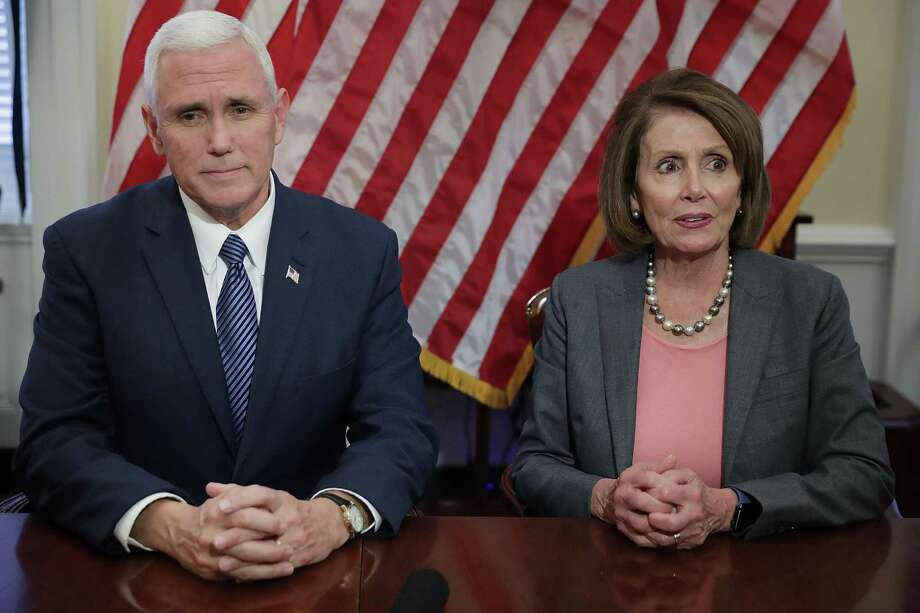 Mike Pence meets with House Minority Leader Nancy Pelosi, seeking to convey respect as Democrats prepare for GOP rule of both chambers of Congress. Photo: Chip Somodevilla / Chip Somodevilla / Bloomberg / © 2016 Bloomberg Finance LP