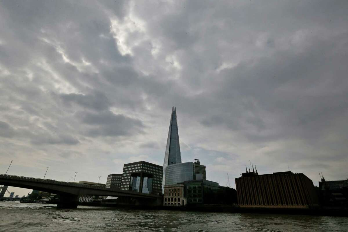 """FILE - In this Thursday, June 19, 2014 file photo, the Shard as seen from the river Thames in London. A new report says a drone just missed hitting an A320 passenger plane flying above the Shard skyscraper in central London in July. The """"very near-miss"""" underscored the fears of many aviation experts about the growing popularity of drones. The plane was approaching Heathrow Airport and flying at nearly 5,000 feet (1,525 meters) when the pilot spotted a 50-centimeter (20-inch) drone off the right flight deck window, it was reported on Thursday, Nov. 17, 2016. (AP Photo/Lefteris Pitarakis, File)"""