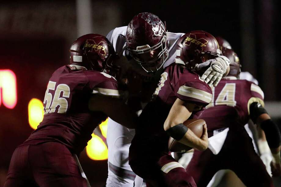 Magnolia Bulldogs defensive lineman Cory Stang (18) sacks Magnolia West Mustangs John Matocha (9) on fourth down on the Magnolia West Mustangs final possession during the high school football game between the Magnolia Bulldogs and the Magnolia West Mustangs at Mustang Stadium in Magnolia, TX on Friday, October 14, 2016.  The Bulldogs defeated the Mustangs 21-14. Photo: Tim Warner, Freelance / Houston Chronicle
