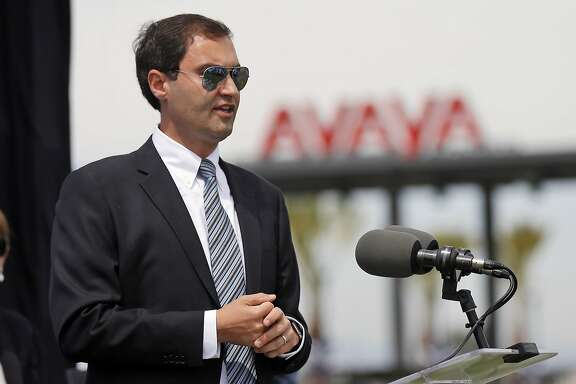 FILE - In this May 28, 2015, file photo, Dave Kaval, president of the San Jose Earthquakes, speaks at a press conference at the team's new Avaya Stadium in San Jose, Calif. Kaval will fill Oakland Athletics team President Michael Crowley's position as Crowley is stepping away from day-to-day operations after nearly 20 years in the role but still advising the A's ownership group. Kaval will also keep his same position with the MLS team. (Patrick Tehan/San Jose Mercury News via AP, file)