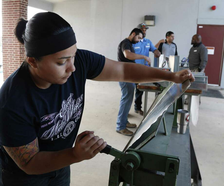 Amanda Alonzo works on a  tool box at Sheet Metal Workers Local 67 which is offering a free five-year apprenticeship program and they're looking for a few good women as well as men.  She is is a first year apprentice. It's touted as an alternative to a traditional college education on Thursday, November 17, 2016. Photo: Ronald Cortes, Freelance / For Express News