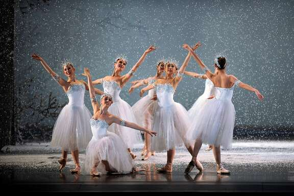 "A flurry of flakes begins to fall on San Francisco Ballet dancers in ""The Nutcracker.""  Photo by Erik Tomasson"