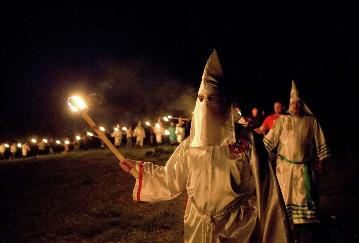 A Georgia lawmaker has discarded an effort to revise a law that targets the Ku Klux Klan after critics said the change was aimed at Muslim religious headgear.