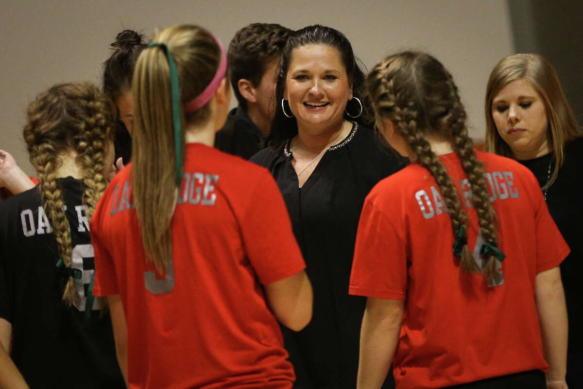 Oak Ridge head coach Tommie Sledge talks to her team during a timeout in the varsity volleyball game against The Woodlands on Saturday, Nov. 12, 2016, at Johnson Coliseum in Huntsville, Texas. (Michael Minasi / Chronicle)