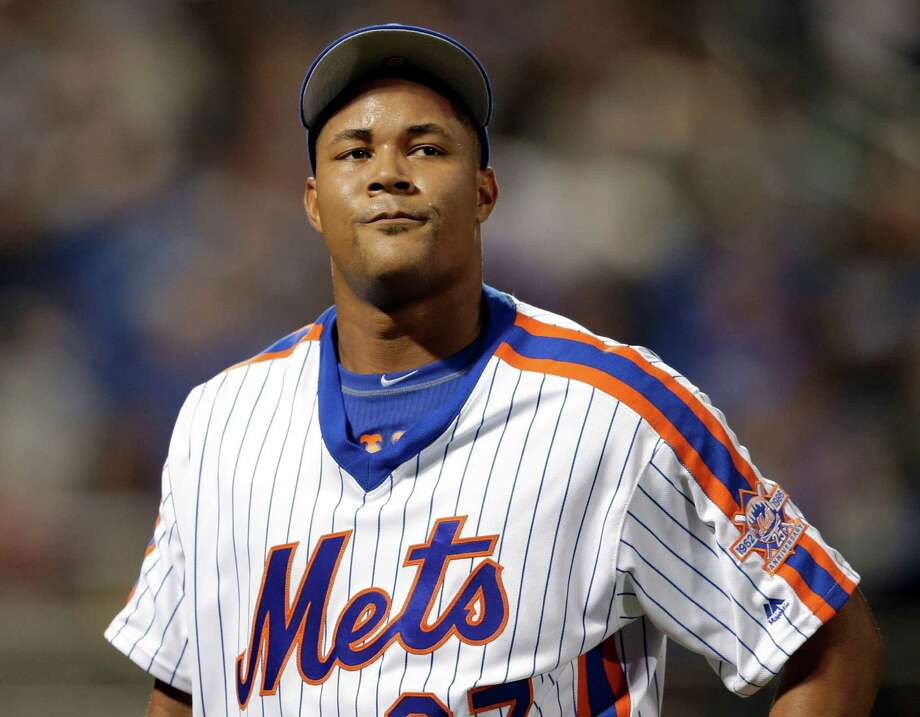 """FILE - In this May 29, 2016, file photo, New York Mets relief pitcher Jeurys Familia reacts as walks off the field during the ninth inning of the baseball game against the Los Angeles Dodgers at Citi Field in New York. The wife of New York Mets pitcher Jeurys  Familia said her husband was drunk and """"going crazy"""" in her call to police following a domestic violence incident on Halloween. (AP Photo/Seth Wenig, File) ORG XMIT: NY161 Photo: Seth Wenig / Copyright 2016 The Associated Press. All rights reserved. This m"""