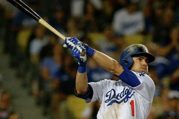 The Los Angeles Dodgers' Josh Reddick follows through on a grand slam against the Colorado Rockies in the seventh inning on Saturday, Sept. 24, 2016, at Dodger Stadium in Los Angeles. (Luis Sinco/Los Angeles Times/TNS)