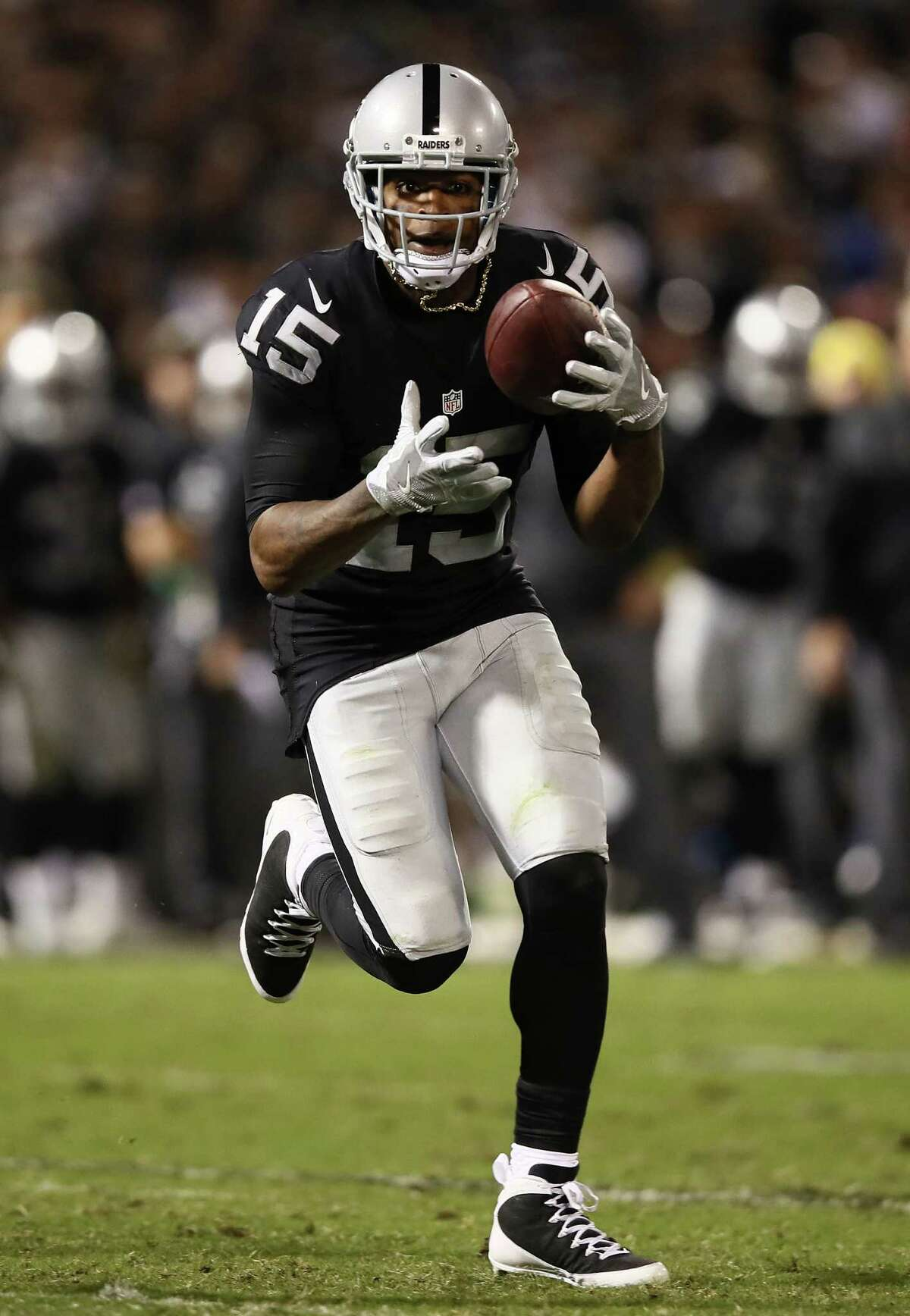 Oakland's Amari Cooper, left, and Michael Crabtree have combined for 107 receptions for 1,439 yards and eight touchdowns this season.
