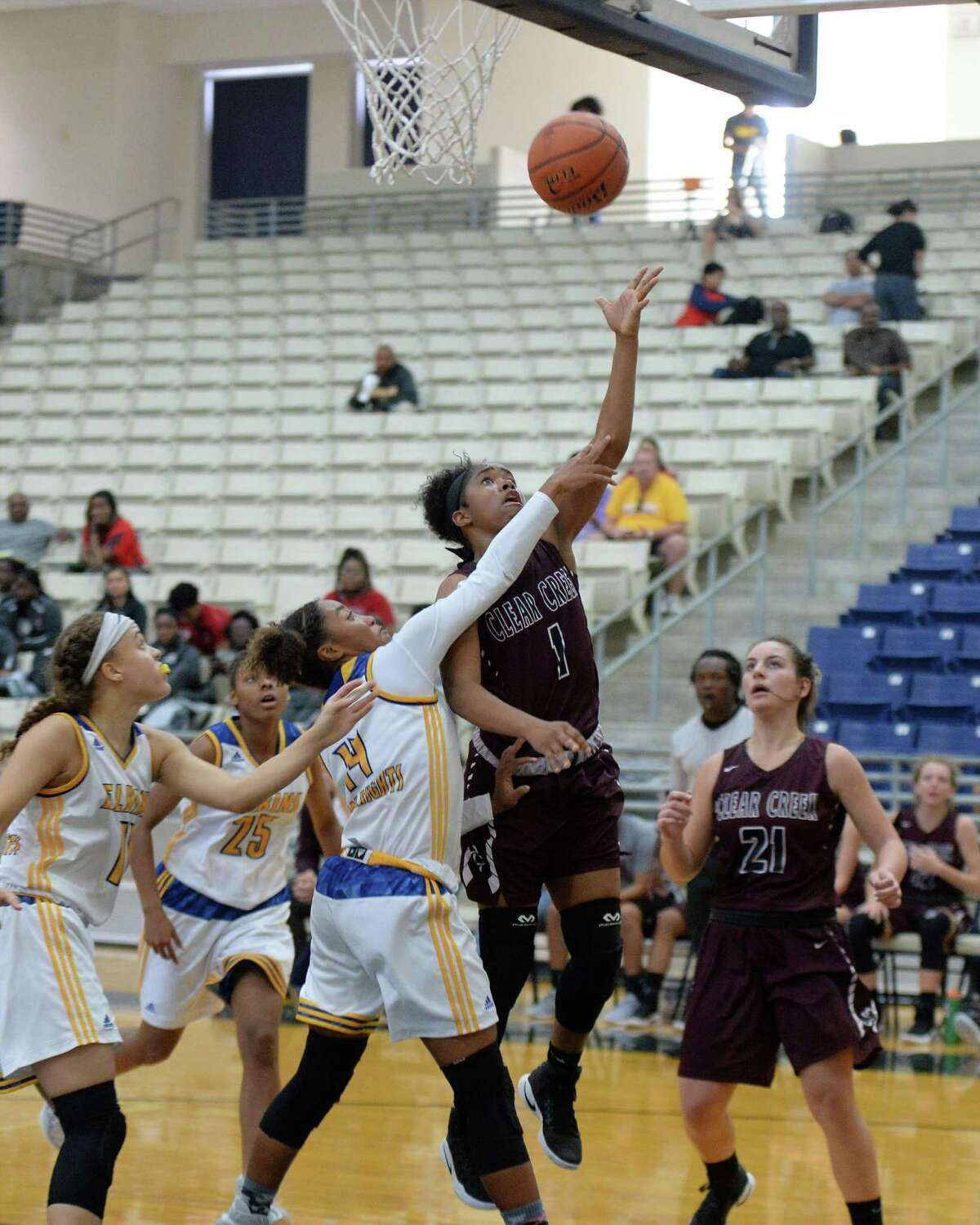 Keondra White (1) of Clear Creek attempts a lay-up in the second half of a basketball game between the Clear Creek Wildcats and the Elkins Knights during the Ft. Bend ISD Varsity Girls Tournament on Thursday November 17, 2016 at the Buddy Hopson Field House, Missouri City, TX.