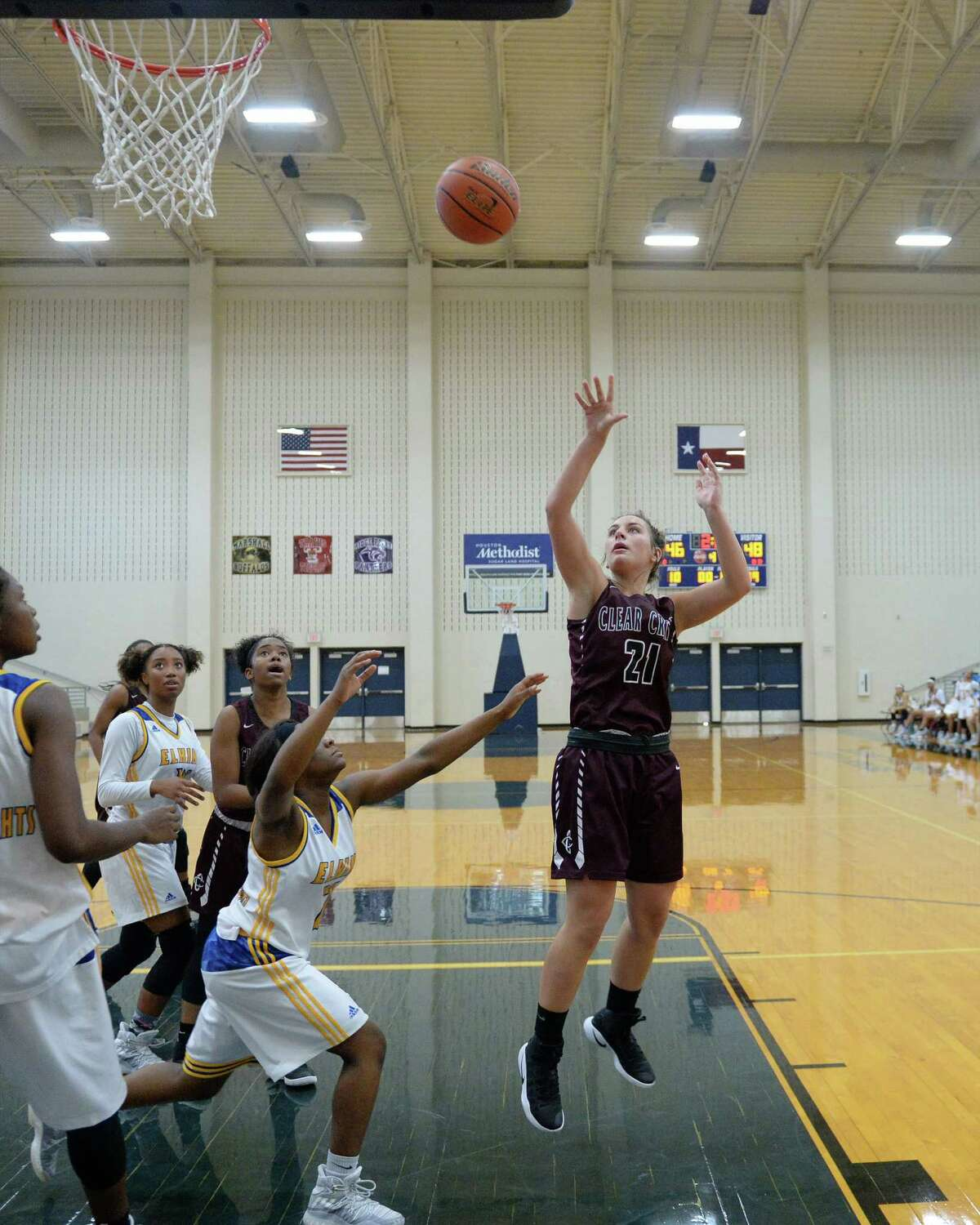 Alex Simmons (21) of Clear Creek attempts a jump shot during the overtime period of a basketball game between the Clear Creek Wildcats and the Elkins Knights during the Ft. Bend ISD Varsity Girls Tournament on Thursday November 17, 2016 at the Buddy Hopson Field House, Missouri City, TX.