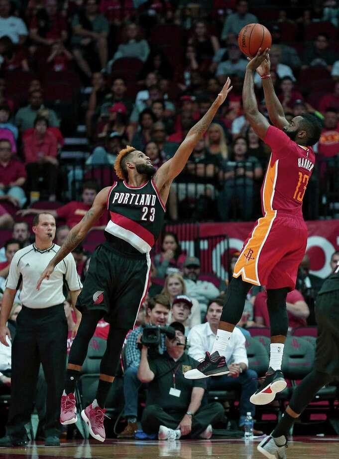 Houston Rockets guard James Harden (13) shoots over Portland Trail Blazers guard Allen Crabbe (23) in the first half of an NBA basketball game on Thursday, Nov. 17, 2016, in Houston. (AP Photo/Bob Levey) Photo: Bob Levey, Associated Press / AP