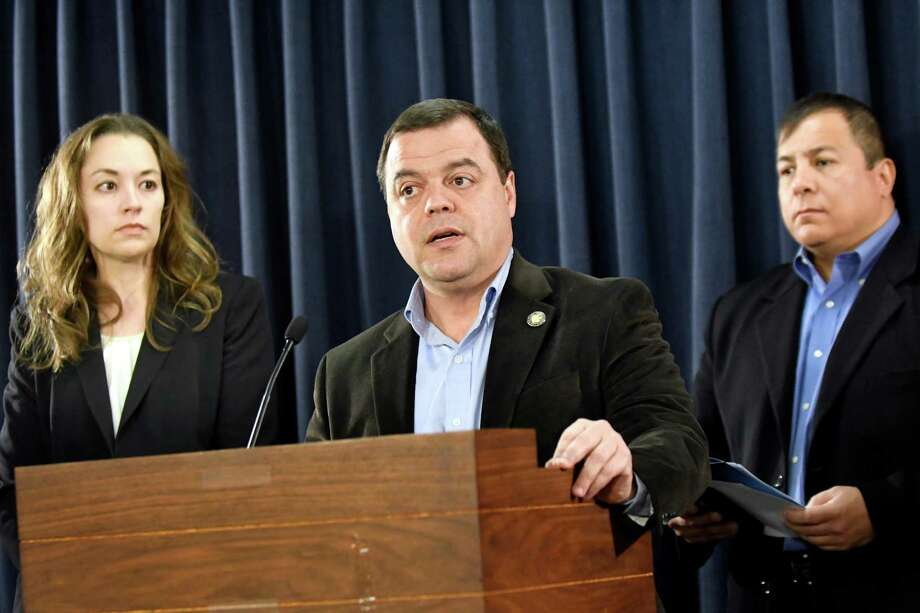 Assemblyman Luis Sepulveda, center, talks about the uncertainty for millions of undocumented immigrants, including those in the Deferred Action of Childhood Arrivals program, on Wednesday, Nov 16, 2016, at the Legislative Office Building in Albany, N.Y. Joined by Sarah Rogerson, director of the Immigration Law Clinic, left, and Guillermo Martinez, legislative director of the Puerto Rican-Hispanic Task Force, they called on President Obama to pardon and protect all DACA enrollees. (Cindy Schultz / Times Union) Photo: Cindy Schultz / Albany Times Union