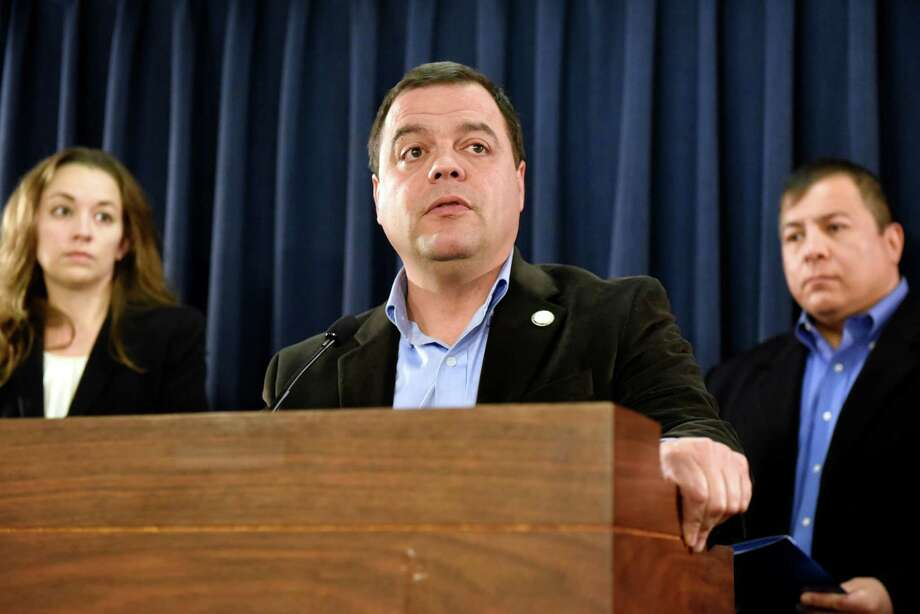Assemblyman Luis Sepulveda, center, talks about the uncertainty for millions of undocumented immigrants, especially those in the Deferred Action of Childhood Arrivals program, on Wednesday, Nov 16, 2016, at the Legislative Office Building in Albany, N.Y. Joined by Sarah Rogerson, director of the Immigration Law Clinic, left, and Guillermo Martinez, legislative director of the Puerto Rican-Hispanic Task Force, they called on President Obama to pardon and protect all DACA enrollees. (Cindy Schultz / Times Union) Photo: Cindy Schultz / Albany Times Union