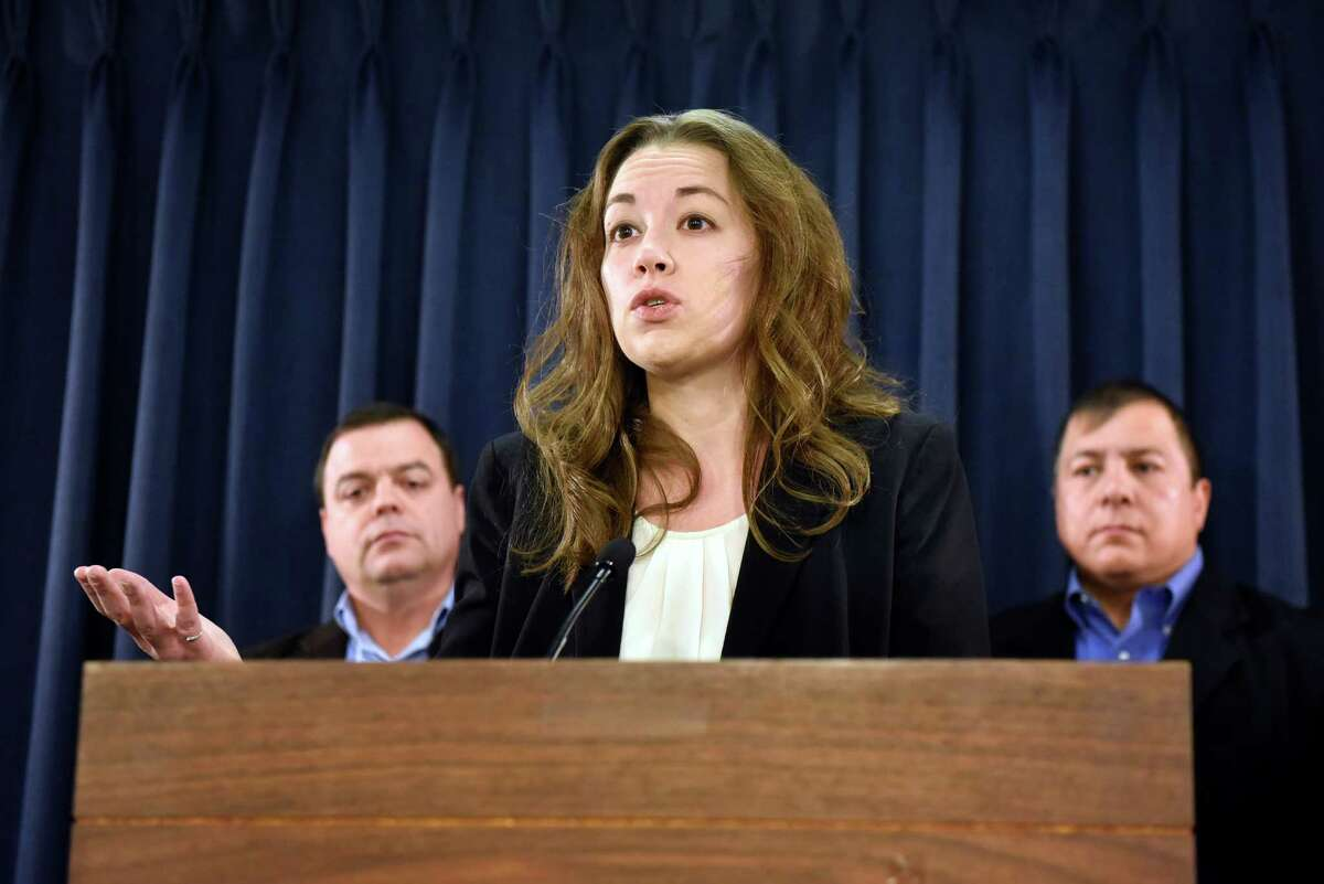 Sarah Rogerson, director of the Immigration Law Clinic, center, talks about the uncertainty for millions of undocumented immigrants, especially those in the Deferred Action of Childhood Arrivals program, on Wednesday, Nov 16, 2016, at the Legislative Office Building in Albany, N.Y. Joined by Assemblyman Luis Sepulveda, left, and Guillermo Martinez, legislative director of the Puerto Rican-Hispanic Task Force, they called on President Obama to pardon and protect all DACA enrollees. (Cindy Schultz / Times Union)