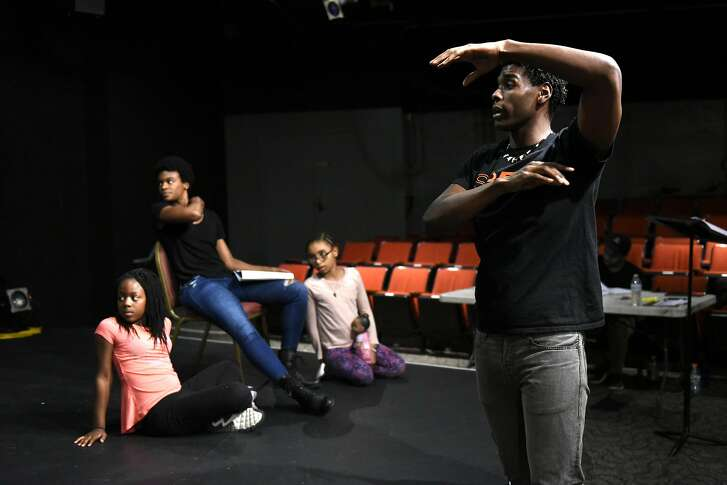 """SFBATCO artistic director Rodney Earl Jackson Jr. gives guidance to actors during a rehearsal of  """"Cinderella"""", a musical production by the African-American Shakespeare Company and the  San Francisco Bay Area Theater Company at the African American Art & Culture Center in San Francisco, CA Monday, November 14, 2016."""