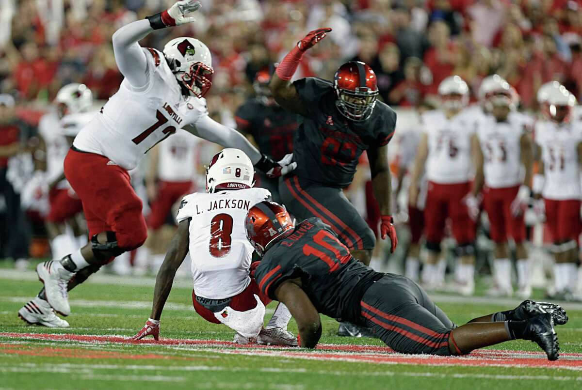 University of Houston defensive tackle Ed Oliver lower right, sacks Louisville Cardinals quarterback Lamar Jackson during the first half of college football game action at TDECU Stadium Nov. 17, 2016, in Houston.