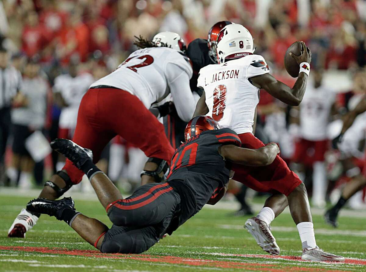 University of Houston defensive tackle Ed Oliver sacks Louisville Cardinals quarterback Lamar Jackson during the first half of college football game action at TDECU Stadium Nov. 17, 2016, in Houston.